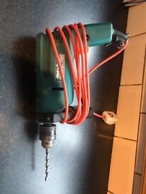 Corded black and decker drill with masonry bit.
