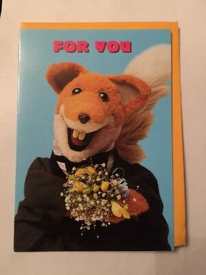 BN For You with Basil Brush holding a Bunch Of Flowers