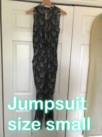 Zip up black and white jumpsuit