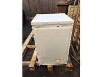 Chest freezer, dented on the front but perfect for garage.