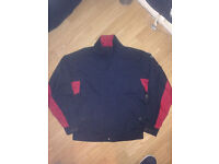 Footjoy black and red golfing jacket small.