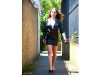 Black leather mini skirt and jacket