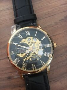 Black and gold mechanical watch