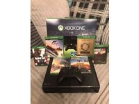 Xbox one 1tb with 7 games and 2 trials [xbox live and ea games]