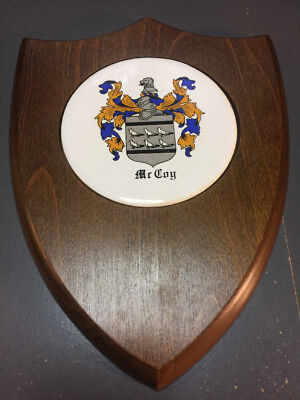 McCoy Family Crest plaque framed in walnut shield
