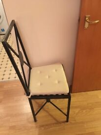 2 metal chairs with cream cushion