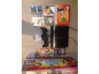 PS3 Bundle with x2 controllers, guitar hero band and various games