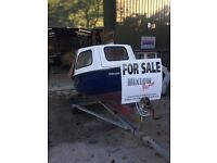 14ft boat trailer and outboard