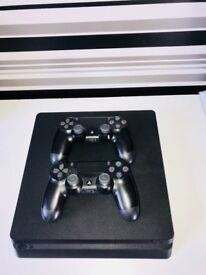 PS4 slim console, 2 controllers with 13 games