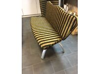 Two newly recovered reception seats black and gold velvet