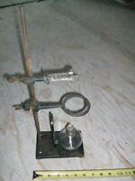 Cenco lab stand with ring support & burette clamp & burner