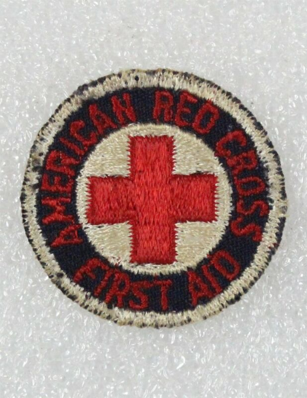 """Red Cross: First Aid patch, 1 1/2"""" round w/red letters on black, cut edge"""