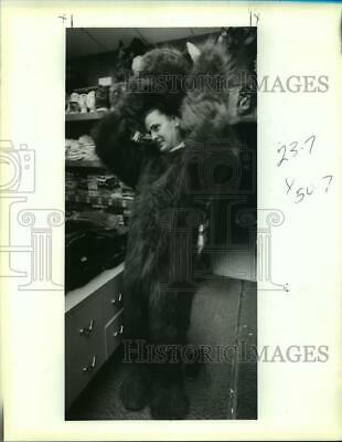 1991 Press Photo Bo Bryson tries on a Cookie Monster costume for Halloween.