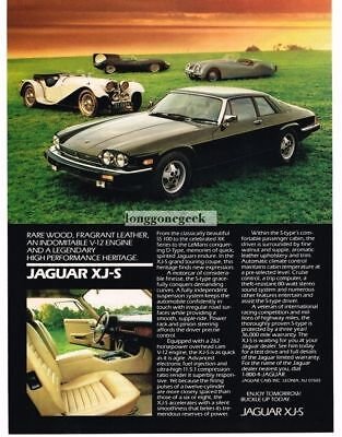 1986 Jaguar XJ-S Black Classic Jags in the background Vintage Ad