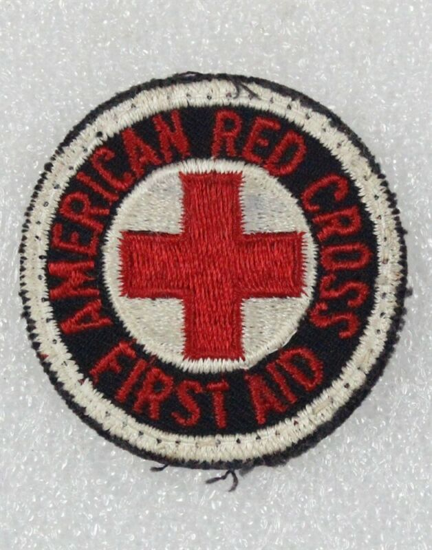 """Red Cross: First Aid patch, 2"""" round w/red letters on black, cut edge"""