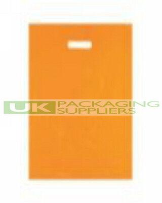 "100 STRONG VARIGAUGE ORANGE COLOUR PLASTIC CARRIER BAGS 15 x 18 x 3"" - NEW"