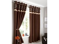 Faux silk brown curtains with panel detail and eyelet rings