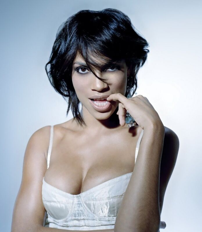 Rosario Dawson With Finger In Mouth 8x10 Photo Print