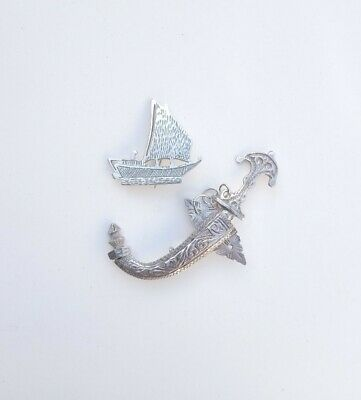 Two Antique Arabic Silver Handmade Brooches, a Sword and a Dhow Boat