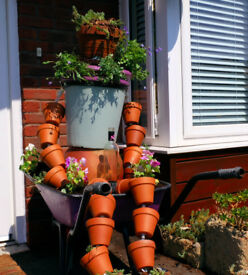 Unique |Terracotta + Ceramic Large Plant Pot Man in Flower Filled Metal Wheelbarrow