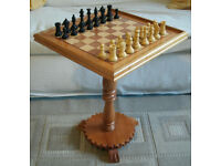Chess set on pedestal table