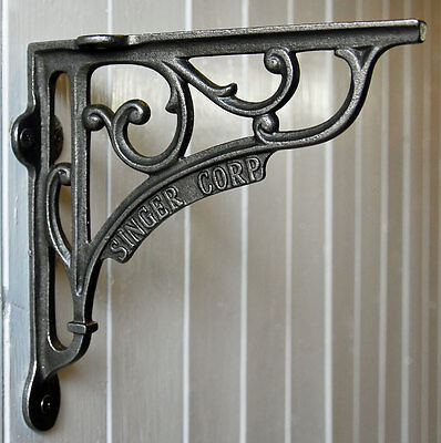 Cast metal vintage style Singer Corporation wall shelf bracket