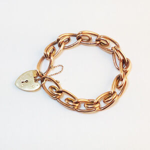 Vintage Victorian 9ct gold link bracelet with heart padlock and safety chain