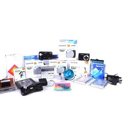 Lot of Polaroid Cameras, Film, and Camera Accessories - (AI)