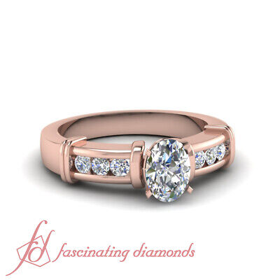 1 Carat Oval Shaped Diamond Channel Set Engagement Ring With Round Accents GIA