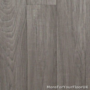 Mid grey wood plank vinyl flooring slip resistant lino 4m for Cushion floor tiles kitchen
