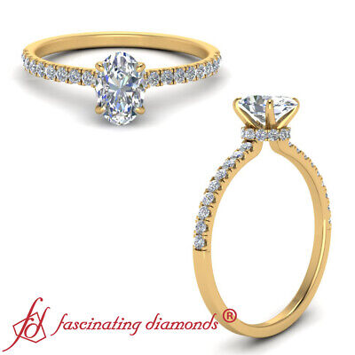 1.25 Carat Oval Shaped Diamond Delicate Band Engagement Ring With Round Accents