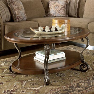 Signature Design By Ashley Nestor Cocktail Table  Brown