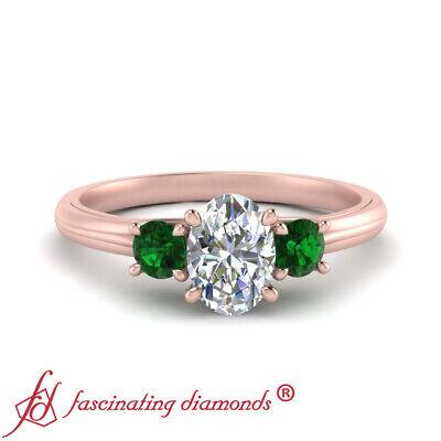 Oval Shaped Diamond And Emerald Gemstone Three Stone Engagement Ring 0.90 Ctw 1