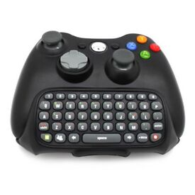 Black Xbox 360 with controller and key pad