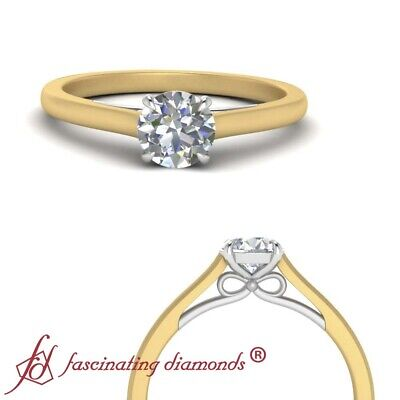 Two Tone Solitaire Bow Pattern Engagement Ring With 1/2 Carat Round Cut Diamond