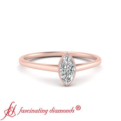 Solitaire 1/2 Carat Marquise Cut Diamond Bezel Set Engagement Ring In Rose Gold