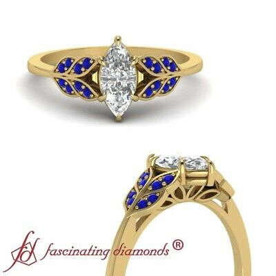 Antique Leaf Engagement Ring With Marquise Cut Diamond And Sapphire 0.65 Carat