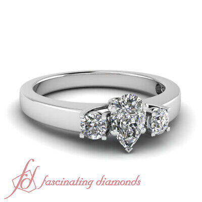 1.25 Carat Pear Shaped And Round Diamond Handmade Engagement Ring GIA Certified