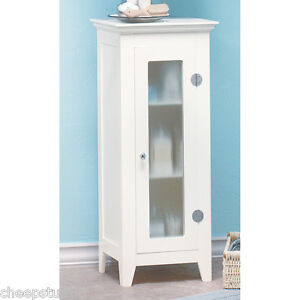 white storage cabinet with glass doors bathroom hall linen