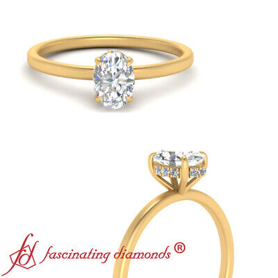 .75 Carat Oval Shaped Diamond Hidden Halo Engagement Ring In 18K Yellow Gold