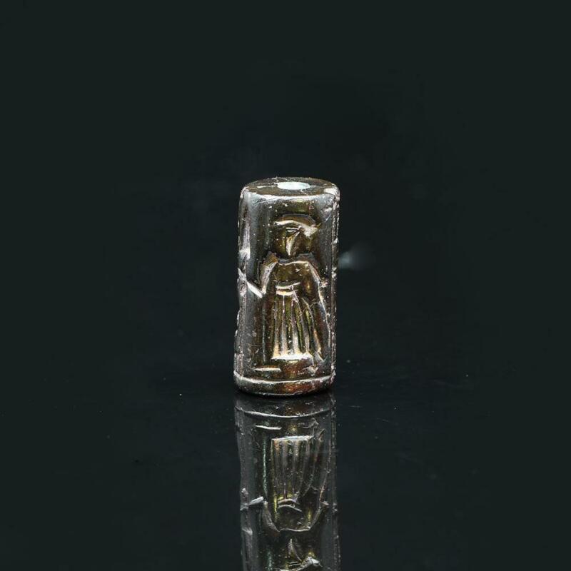 A Mesopotamian Serpentine Cylinder Seal of a Warrior, Age of Hammurabi, ca. 2000
