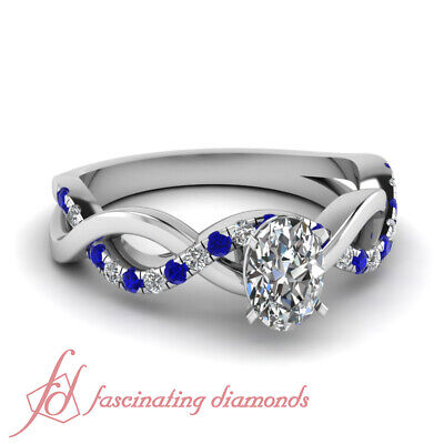 .65 Ct Oval Shaped Diamond & Round Blue Sapphire Engagement Ring SI1-D Color GIA