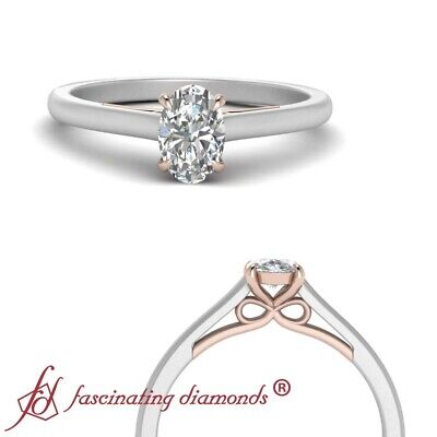 Bow Pattern Solitaire Engagement Ring With 1/2 Carat Oval Shaped Diamond Center