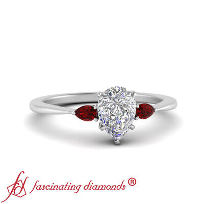 .75 Carat Pear Shaped Diamond And Ruby Gemstone 3 Stone Tapered Engagement Ring