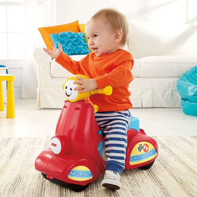 Fisher-Price Laugh & Learn Smart Stages Scooter, Infant Baby Interactive Toy