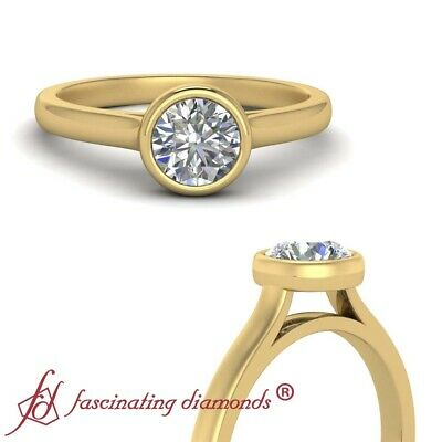 1/2 Carat Round Cut Diamond Simple Solitaire Engagement Ring In 18K Yellow Gold