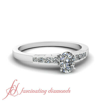 .60 Ct Oval Shaped SI2-F Diamond Rescinding Grid Engagement Ring Channel Set GIA