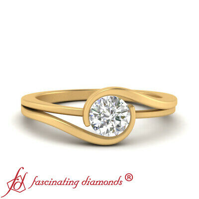 Half Carat Round Cut Diamond Twisted Solitaire Engagement Ring In Yellow Gold