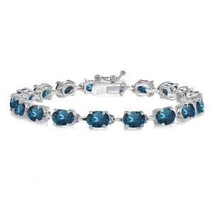 Sterling Silver London Blue Topaz 7x5mm Oval Clic Tennis Bracelet