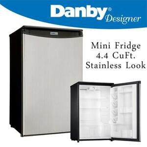 NEW Danby Designer Mini Fridge, 4.4 CuFt. Stainless Look Condtion: New, One edge is bent, Stainless Look, 4.4 cu.ft a...
